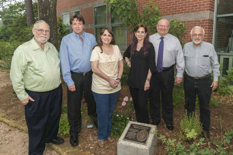 Rosemary Buono Roe's family attended the dedication of the Rosemary Buono Roe Memorial Garden. Pictured from left to right is Cliff Roe (husband), Darin Buono (son), Sherry Buono (daughter), Lori Cohn (daughter), James M. Stinson (P.E. general manager of WJPA) and Bob Dailey, water awareness and public education coordinator for TWJPA. . Photo: Ted Washington