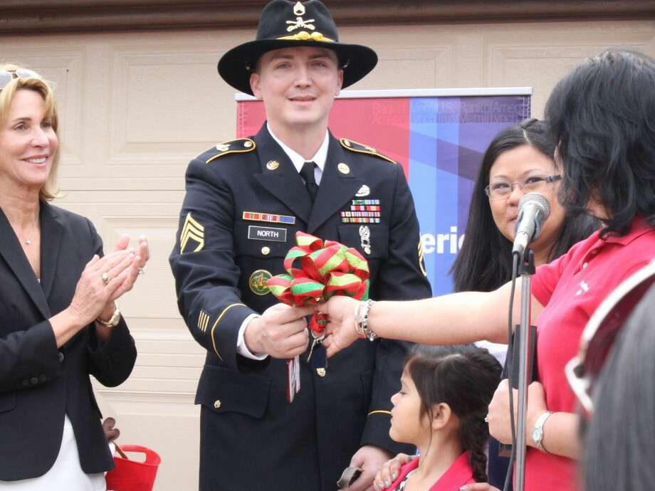 Bank of America and Texas Sentinels Foundation presented keys to a newly-renovated and mortgage-free home to wounded Army veteran, Sergeant Jason North. Photo: Minza Khan
