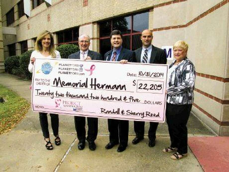 Jodi Morris of World Class Automotive (left) presents a check from Randall Reed Planet Ford to (from left) Tim Baker, Northeast Hospital Foundation president; Memorial Hermann Northeast Hospital CEO Louis Smith; Memorial Hermann Northeast Hospital COO Heath Rushing and Nancy Allen with the Northeast Hospital Foundation.