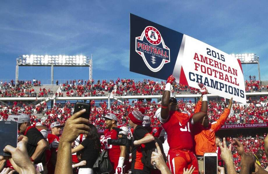 University of Houston players celebrate the Cougars' 24-13 victory over Temple in the AAC title game on Saturday. Houston (12-1) faces Florida State in the Peach Bowl on December 31 in Atlanta.