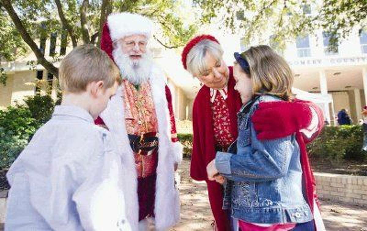 Santa Jim and Mrs. Claus talk to kids on Adoption Day at the Conroe Courthouse in November.
