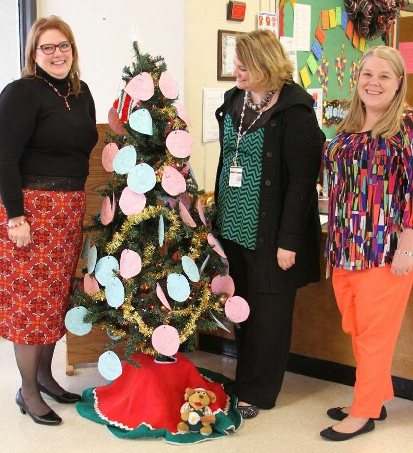 JSE/CIS Principal Stephanie Mizelle, CIS Asst. Principal Jennifer Williams and JSE/CIS Counselor Angel Ballew (left to right) show off the CIS Angel Tree. Photo: Submitted