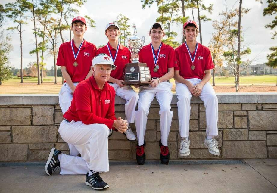Members of the St. Thomas golf team, along with head coach Billy Tuten, show off the Dick Harmon Memorial Texas High School Golf Tournament championship trophy they secured after winning the recent meet at the Golf Club of Houston, formerly known as the Redstone Gold Club in Humble. The Eagles won the team event and were led by gold medalist Clay McCrory, who finished with a two-day, 36-hole total of 148 for first place.