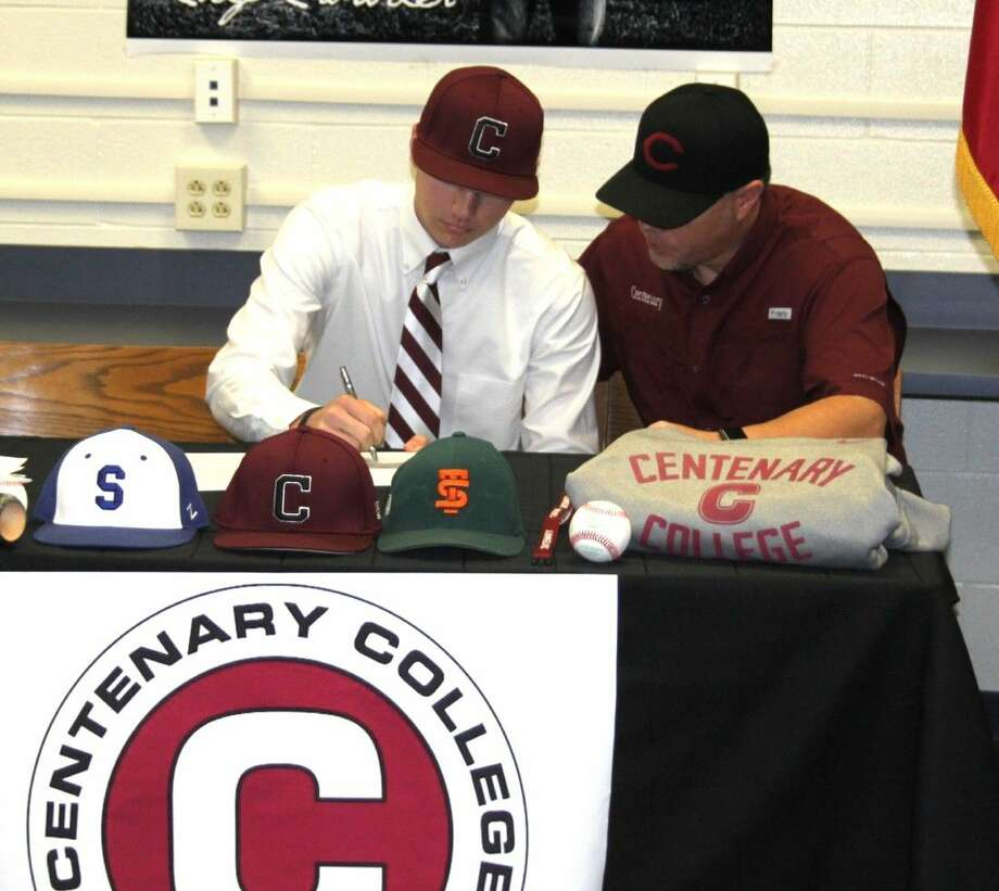 Cody Crowder (left) signs on to play for Centenary College next to his father, Clint Crowder. Photo: Jacob McAdams