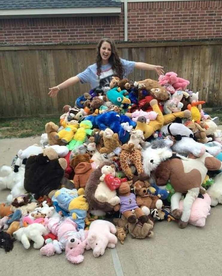 Hunter Kolon, a junior at Klein Oak High School, shows off some of the more than 870 gently used stuffed animals to be donated to HCC Children's Closet of Houston. Photo: Submitted Photo