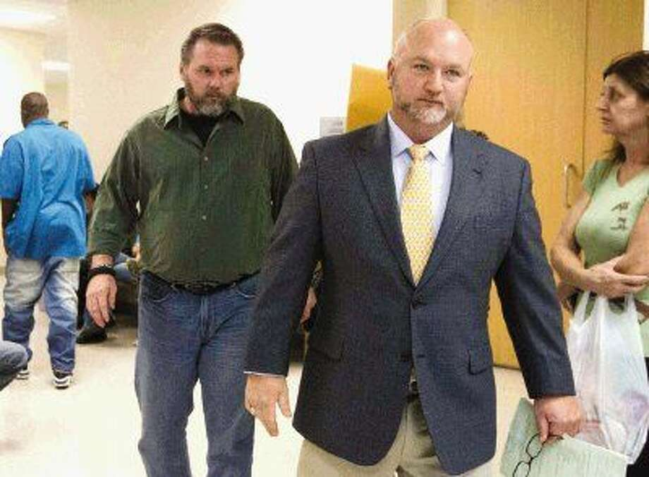 Ed Blackwell, left, walks out of the 221st state District Court with defense attorney E. Tay Bond, right, after Blackwell's triple intoxication manslaughter case was dismissed Tuesday. Blackwell was ruled incompetent to stand trial by a Montgomery County jury Sept. 24. Photo: Jason Fochtman