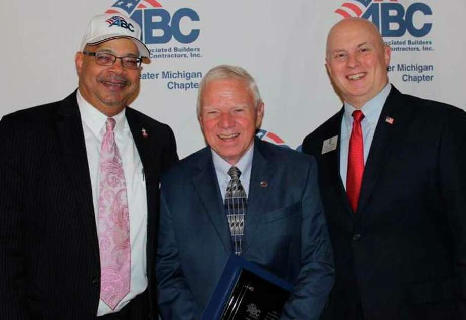 Midland entrepreneur and philanthropist John Bartos, center, received the Associated Builders and Contractors-Greater Michigan Chapter's highest honor, The Founders Award, during the organization's first annual Excellence in Construction Awards banquet. Bartos founded Three Rivers Construction in 1976. ABC President/CEO Jimmy Greene, left, made the presentation, as Rep. Gary Glenn, R-Midland, attended.