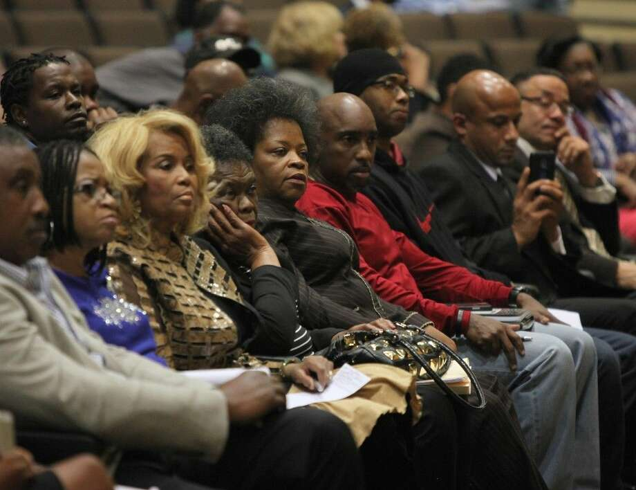 """Members of the audience listen to the speakers at """"Getting Criminal Justice Right,"""" a community town hall meeting on the Eric Garner and Michael Brown cases, at Thurgood Marshall High School in Missouri City on Tuesday, Dec. 9. Photo: Alan Warren"""