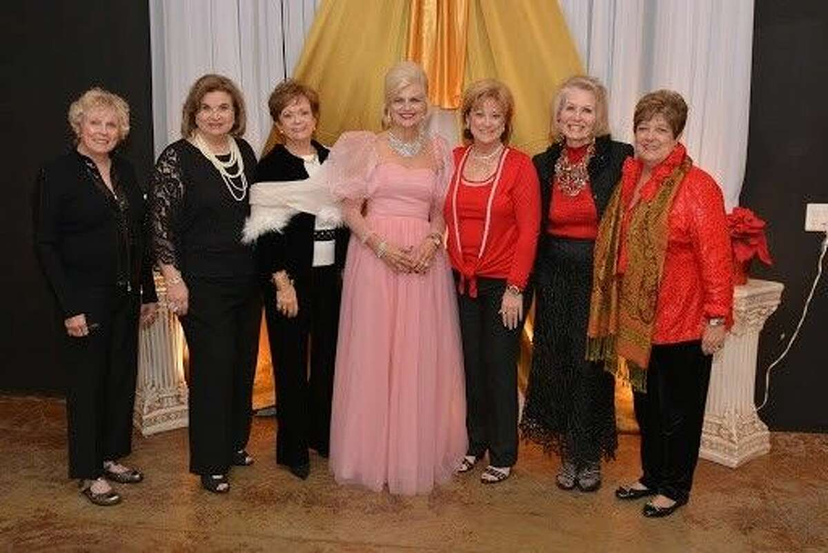 Fundraising Chair Diane Lipton and Co-Presidents Gina Wolford and Susan Cofran with members of the Guild.