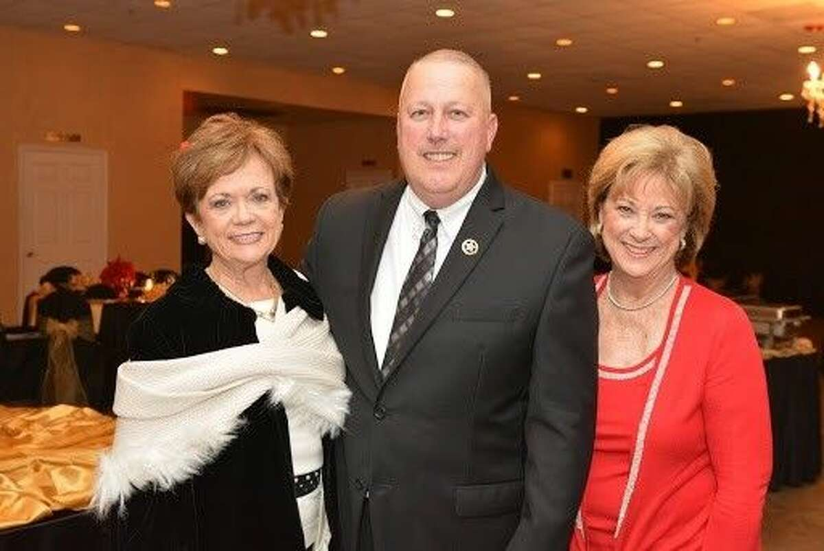 Constable Mark Herman with Texas Repertory Theatre Guild Co-Presidents Gina Wolford and Susan Cofran.