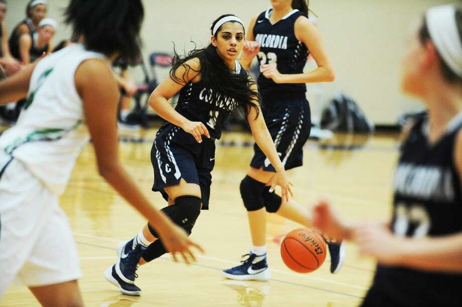 Concordia senior point guard Sana Gilani directs traffic for the Lady Crusader offense in round one of the Katy Classic at Tompkins High School Thursday, Dec. 3. Photo: Photographer