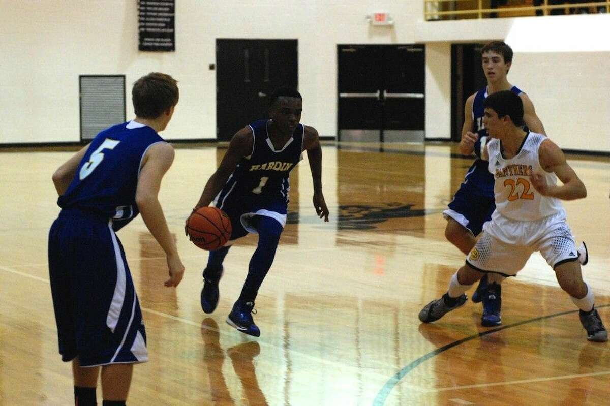 Kameron Wright drives in for the Hornets against Liberty, Tuesday night, Dec. 16, 2014. Wright scored 16 points in the game.