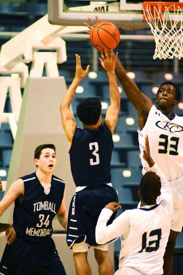 Klein Collins junior forward Jaylon Johnson goes up high to block Tomball Memorial sophomore guard MIkey Fournier's jump shot, one of five blocks Johnson had against the Wildcats, Saturday, December 5, 2015 at the Merrell Center. Photo: Photographer