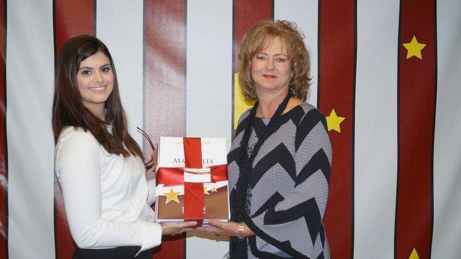 Emerus Community Hospital representative Lindsay Borras (left) donates a stack of the 1,000 homework folders to J.L. Lyons Elementary Principal Tammy Haley (right). Photo: Photo Courtesy Of Emerus