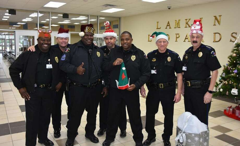 CFISD command staff gather at Lamkin Elementary while wearing festive hats before surprising staff with a blue Christmas tree on Dec. 2. Pictured (L-R) are Sgt. Cedric Nolly, Lt. Joseph Sanders, Sgt. Patrick Arnett, Capt. Matthew Williams, Lt. Jimmy Banks, Asst. Chief Mike Baker and Chief of Police Alan Bragg.