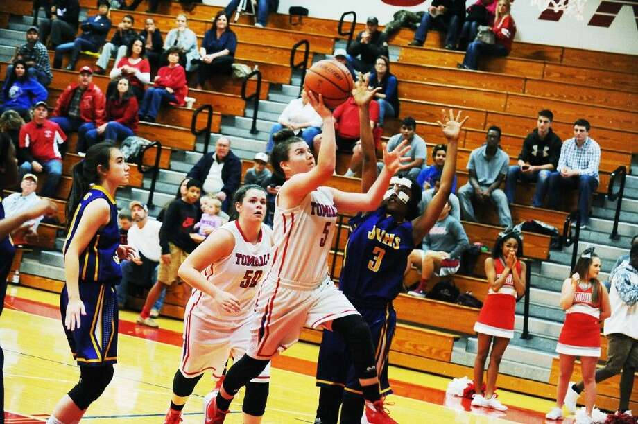 Tomball junior point guard Ashley Hailey puts up a shot against the Jersey Village defenders Tuesday, December 1, 2015 at Tomball High School. Photo: Photographer