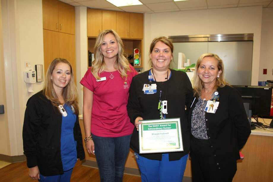 Houston Methodist San Jacinto Hospital Nurse Maggie Inabnett (center), with (from left) 3 West Nurse Manager Jessica Sutterfield, Community Resource Credit Union's Macie Schubert and Houston Methodist San Jacinto Chief Nursing Officer Becky Chalupa.
