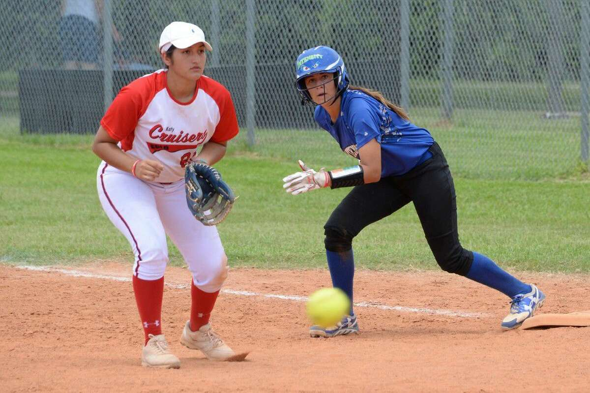 Katy Cruisers' Brittney Estrada prepares to field as Intensity's Ariana Saenz breaks from first during the 16U division at the Mid America Championship national showcase softball tournament July 8-10 at Imperial Park in Sugar Land. Visit HCNPics.com for more photos.