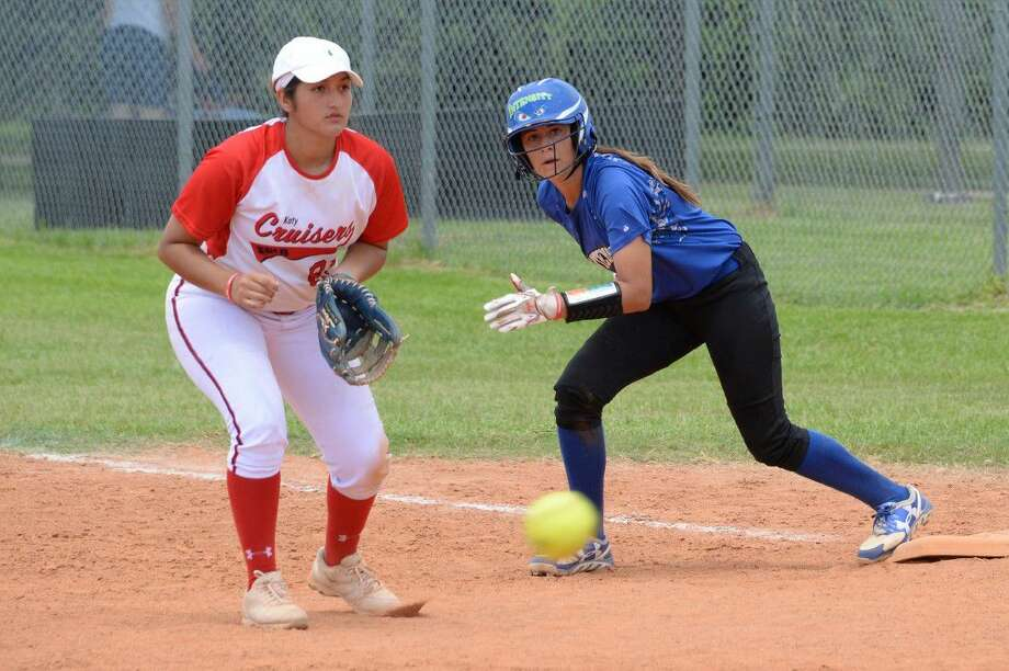 Katy Cruisers' Brittney Estrada prepares to field as Intensity's Ariana Saenz breaks from first during the 16U division at the Mid America Championship national showcase softball tournament July 8-10 at Imperial Park in Sugar Land. Visit HCNPics.com for more photos. Photo: Craig Moseley