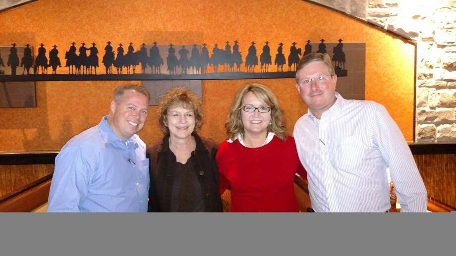 Pictured from left to right are Constable Ryan Gable, Victoria Constance of Children's Safe Harbor, Judge Lisa Michalk 221st District Court and Billy Banks of Longhorn Steakhouse.