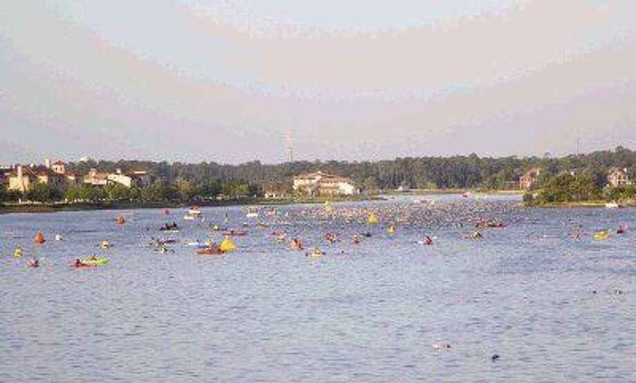 In this file photo, triathletes swim during the 2014 Ironman Texas triathlon in Lake Woodlands. Photo: Staff Photo By Ana Ramirez