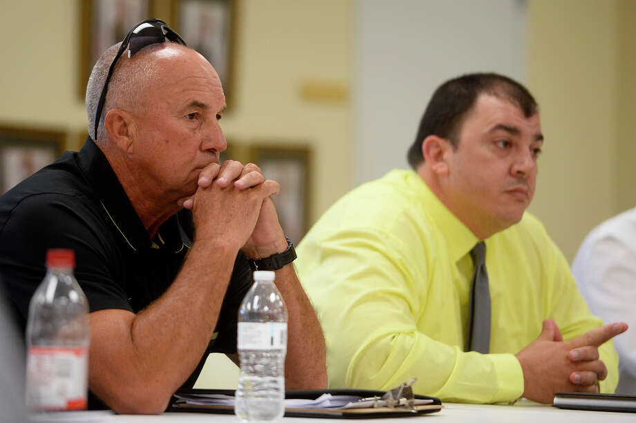 Nederland football coach Larry Neumann listens during a district 22-5A executive committee meeting on Wednesday. Nederland will forfeit their win against Livingston for using an ineligible player, and Neumann will receive a private reprimand.   Photo taken Wednesday 10/5/16 Ryan Pelham/The Enterprise Photo: Ryan Pelham, Ryan Pelham/The Enterprise / ©2016 The Beaumont Enterprise/Ryan Pelham
