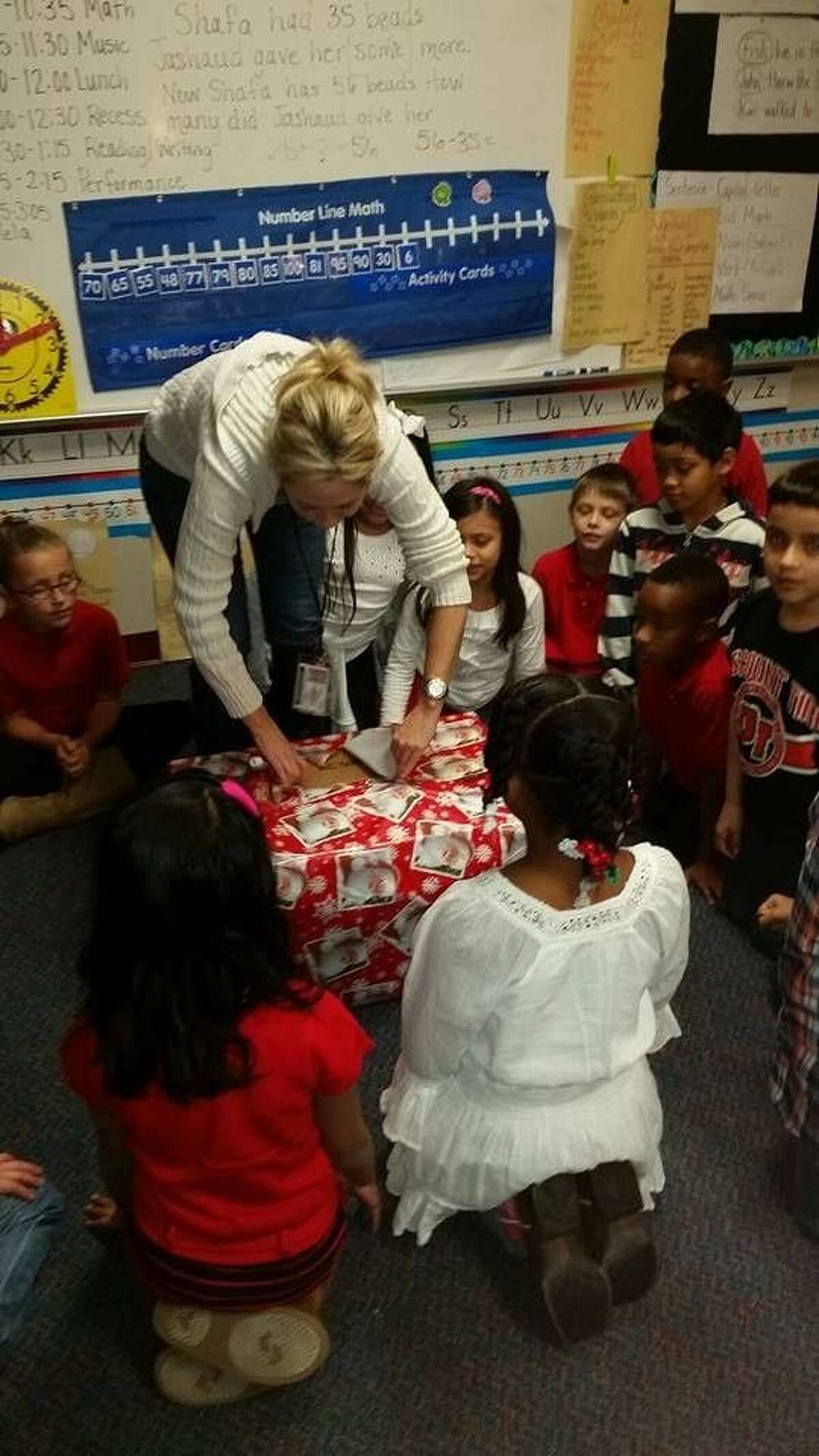 River Pines Elementary students and teachers were surprised on Dec. 16, 2014 with donated sweatshirts with the school's logo, a tree frog, screenprinted across the front.