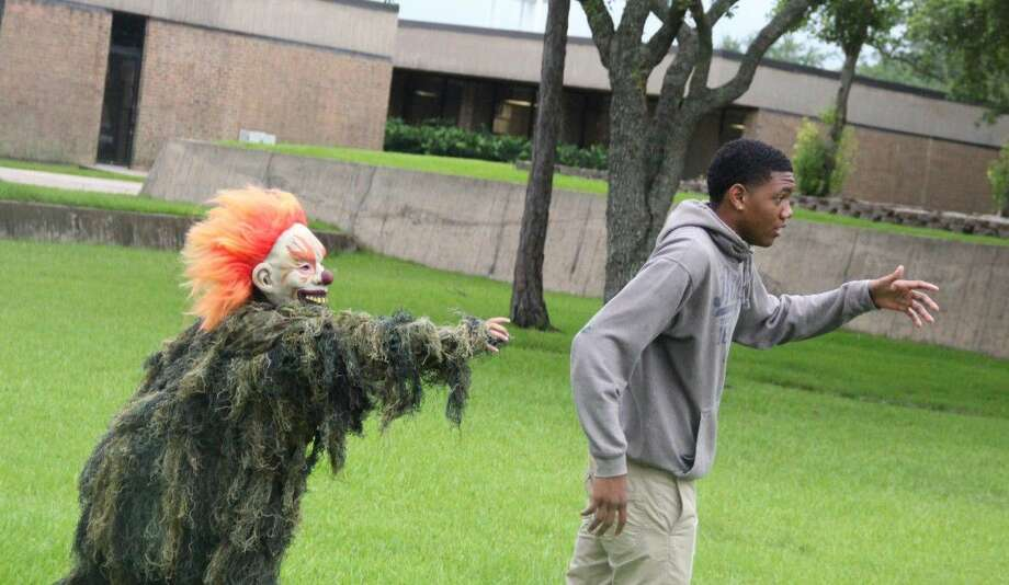 Caleeb Bell and Sidney Gomez (in costume) rehearse for their final film project. In Introduction to Cinema, students learn what makes a movie good, how to fake a punch and which camera angles create a mood.