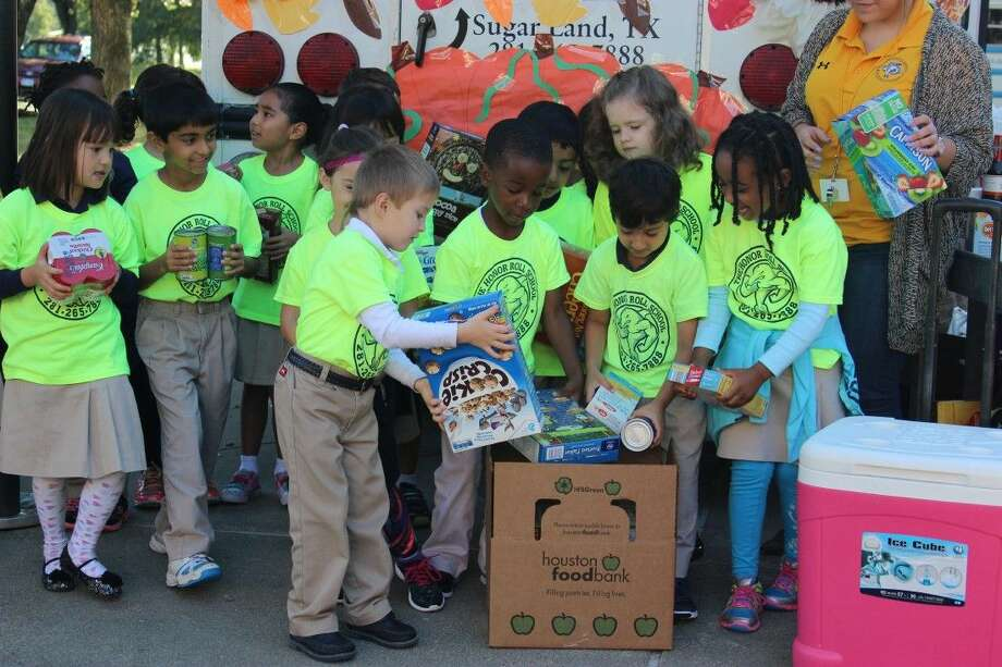 The Honor Roll School students collected food donations for the Houston Food Bank. They will visit the food bank to tour the facility, sort donations, and learn about how contributions benefit the community.