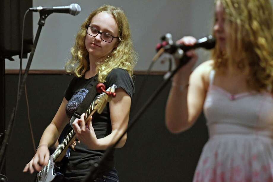 "Claire Holloway, 15, of Amsterdam plays guitar during a ""School of Rock"" a performance at the Overit studio on Tuesday Sept. 27, 2016 in Albany , N.Y. (Michael P. Farrell/Times Union) Photo: Michael P. Farrell / 40038076A"