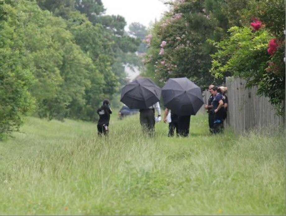Investigators working on crime scene where a body was discovered near Tomball Memorial. Photo: Taelor Smith