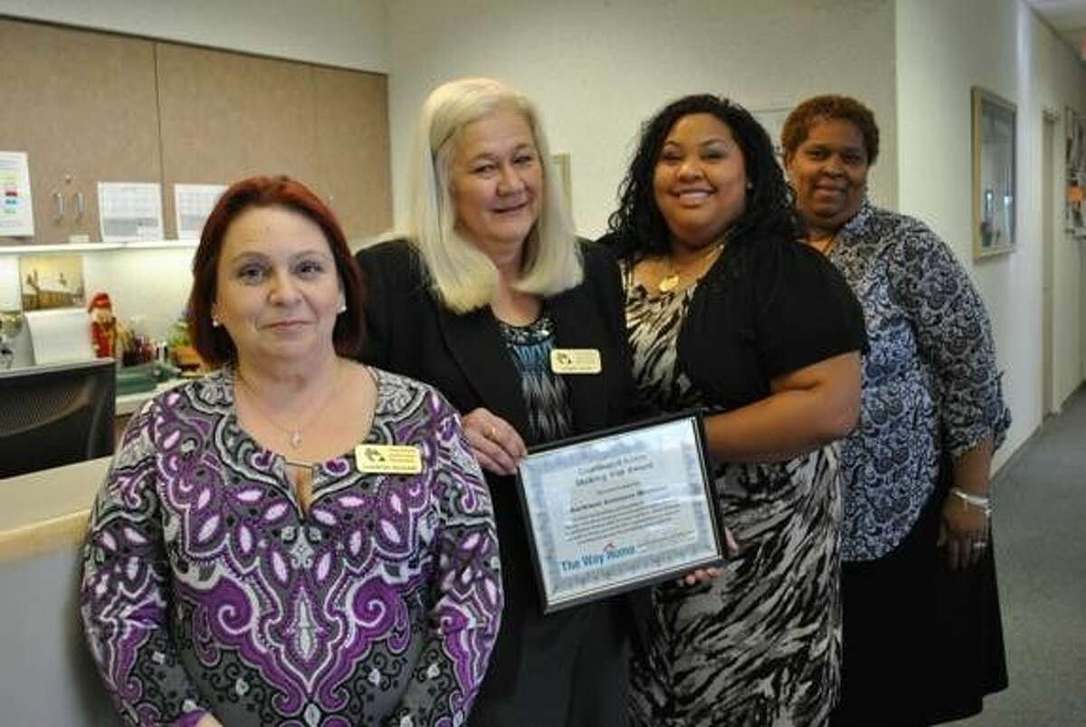 Staff of Northwest Assistance Ministries celebrate the Shining Star Award they received from The Way Home Houston. From left to right, Sharron McGuire, case manager; Debbie Crum, director of Housing Services at NAM; RaSara Rodriguez Allen, case manager; and Karen Weakly, director of the Interfaith Hospitality Network at NAM.