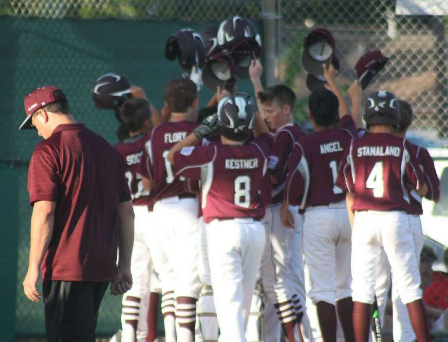Pearland East players give Chris Cano a hero's welcome at home plate after he hit a two-run homer in the first inning. By game's end, the team would hit four homers, three in back-to-back-to-back fashion. Photo: Robert Avery