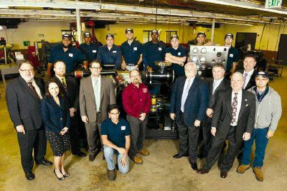 Allison Transmission and Stewart & Stevenson donate a diesel transmission trainer at Lone Star College-North Harris. The donation, secured by the Lone Star College Foundation, will be used to help train students for work in the industrial diesel industry. Pictured are representatives from Lone Star College, Allison Transmission, Stewart & Stevenson and LSC industrial diesel technology students.