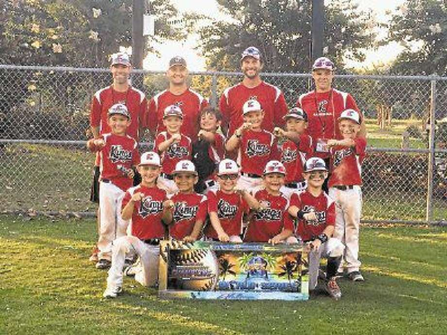 Shown here are the USSSA 7U AAA World Series champion Woodlands Kings Baseball Black team. Bottom Row (left to right): Camden, Sean, Braden, Tripp and Colson. Top Row: Trey, Carson, Carter, Jackson, Saul and Tanner. Coaches: Zach Sanches, Chris Cahal, Aaron Surber and Greg Smith.