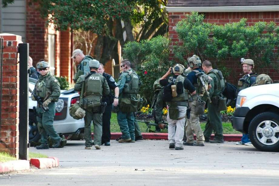 A response task force comprised of officers from Galveston County, League City and Pearland respond to an incident involving an individual that barricaded himself in an apartment after shots were fired Tuesday, Dec. 8