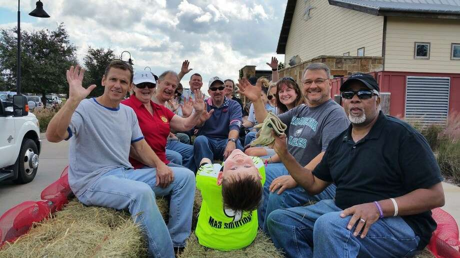 Holiday Hay Riders! - Members of the Brazos River Rotary Club take a practice run in the hay wagon in preparation for the Holiday Hayride at Cross Creek Ranch.