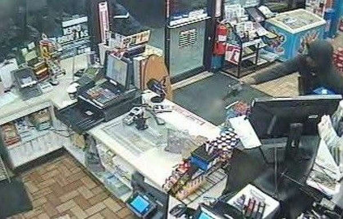 One suspect also allegedly fired a shot leaving the store, narrowly missing the store clerk.