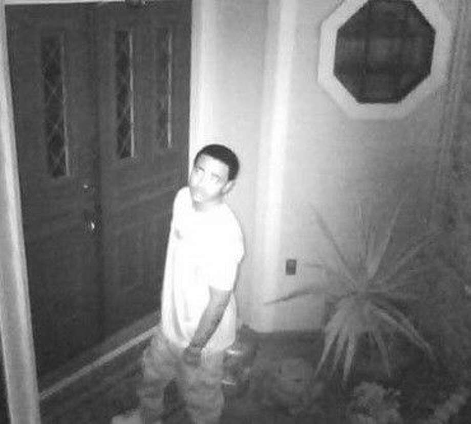 Pictured is a video image of an alleged home burglar in a Pecan Grove case. Video shows the alleged suspect as being a young black male, in his early 20s, wearing a white t-shirt, loose cargo pants, and tennis shoes.