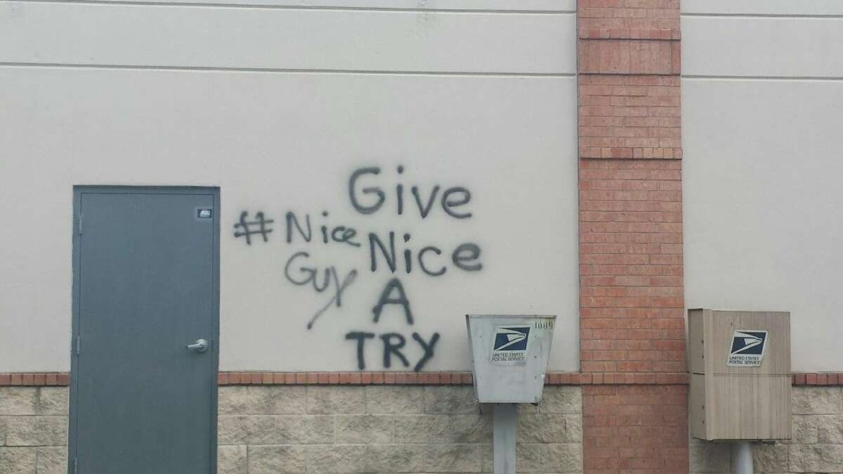 The graffiti on Kingwood Town Center businesses such as this from Wednesday, Dec. 9, 2015, has been hard for crews to remove.