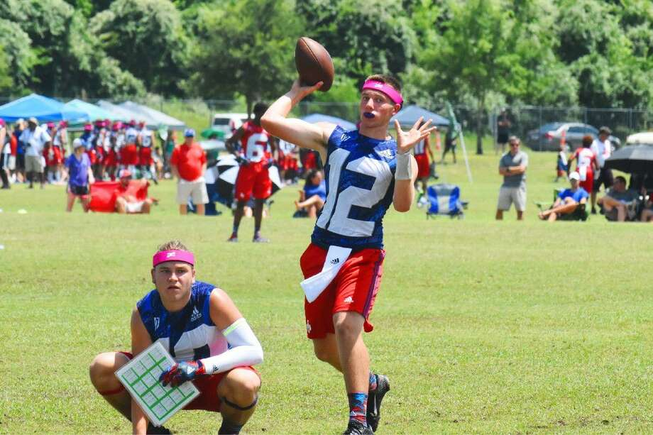Cy-Fair quarterback Cam Arnold delivers a pass during the pool play round of the Adidas State 7 on 7 Tournament Friday, July 8 at Veterans Park and Athletic Complex in College Station. The Bobcats would sweep their pool, defeat Southlake 41-12 in the Championship Bracket before falling to John Tyler 40-39. Photo: Tony Gaines
