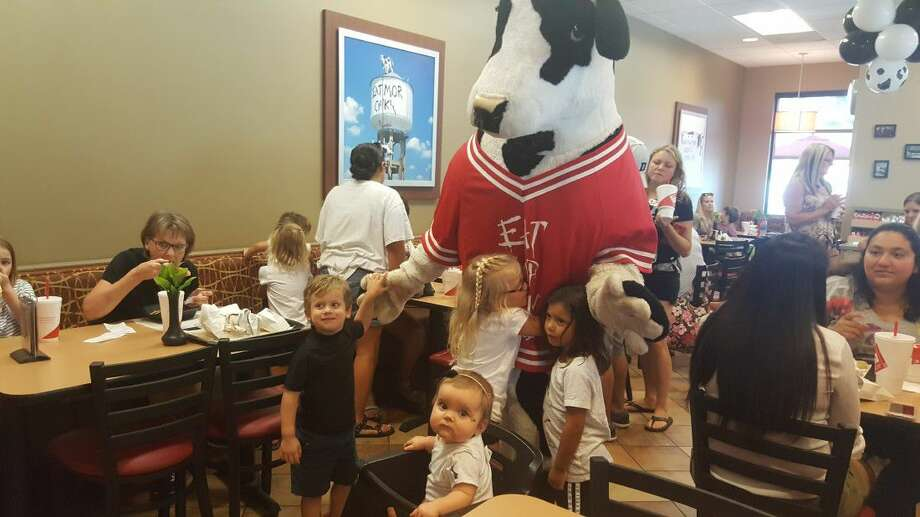 Children are eager to meet the the Chick-fil-A cow during Cow Appreciation day at Chick-fil-A on Northpark Drive in Kingwood Tuesday, July 12.