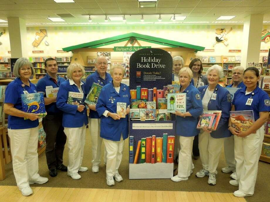 Pictured at the 10th Annual Holiday Book Drive at Barnes & Noble Deerbrook (from left to right) is Memorial Hermann Northeast Hospital volunteer Marianne Bechtol, Kevin Boney with Barnes & Noble; Memorial Hermann Northeast volunteers Janie Dampier, Bob Herring, Rances Herring, Mary Slaughter, Michele Wolf, Memorial Hermann Northeast Volunteer Services Manager Elizabeth Tise, and volunteers Paula McCreary, Alison Olson and Berly Williams. Photo: Picasa