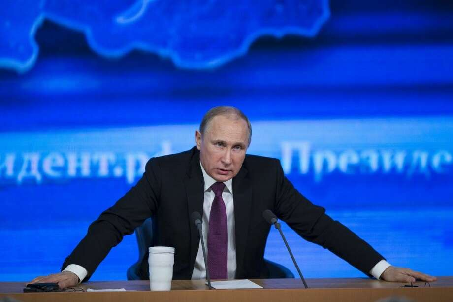 Russian President Vladimir Putin speaks during his annual news conference Thursday in Moscow. The Russian economy will rebound and the ruble will stabilize, Putin said. He also said Ukraine must remain one political entity, voicing hope that the crisis could be solved through peace talks.
