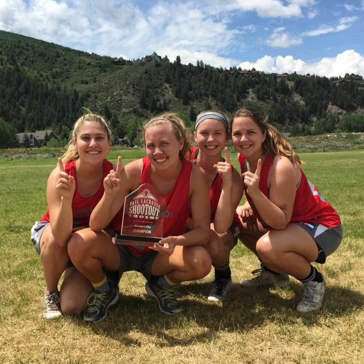 Several members of the Houston Heat Lacrosse team with their trophy from the Vail Shootout. The team wound up finishing third in their bracket