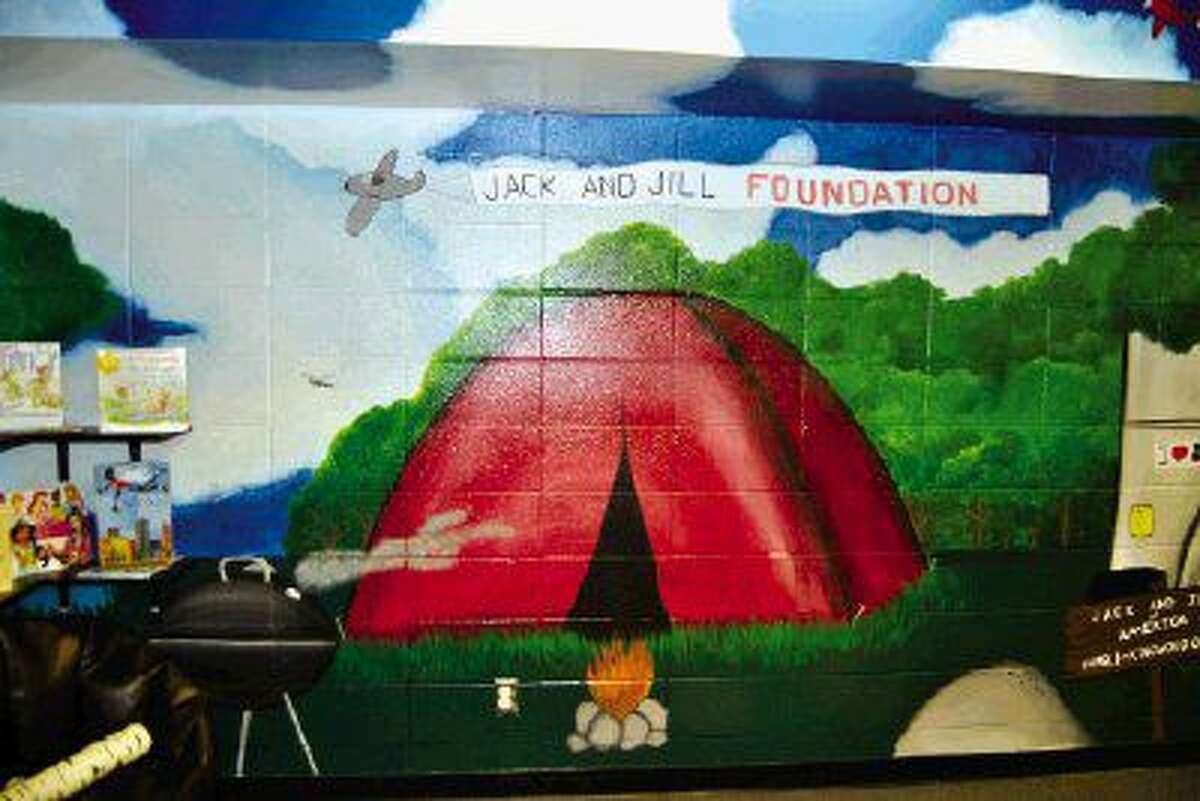 The chapter has designed a camp-themed reading area filled with high-interest books, technology, and a writing nook. The space features comfortable seating options based on the camp theme and customized murals illustrated by Artist Benjamin Buggs.
