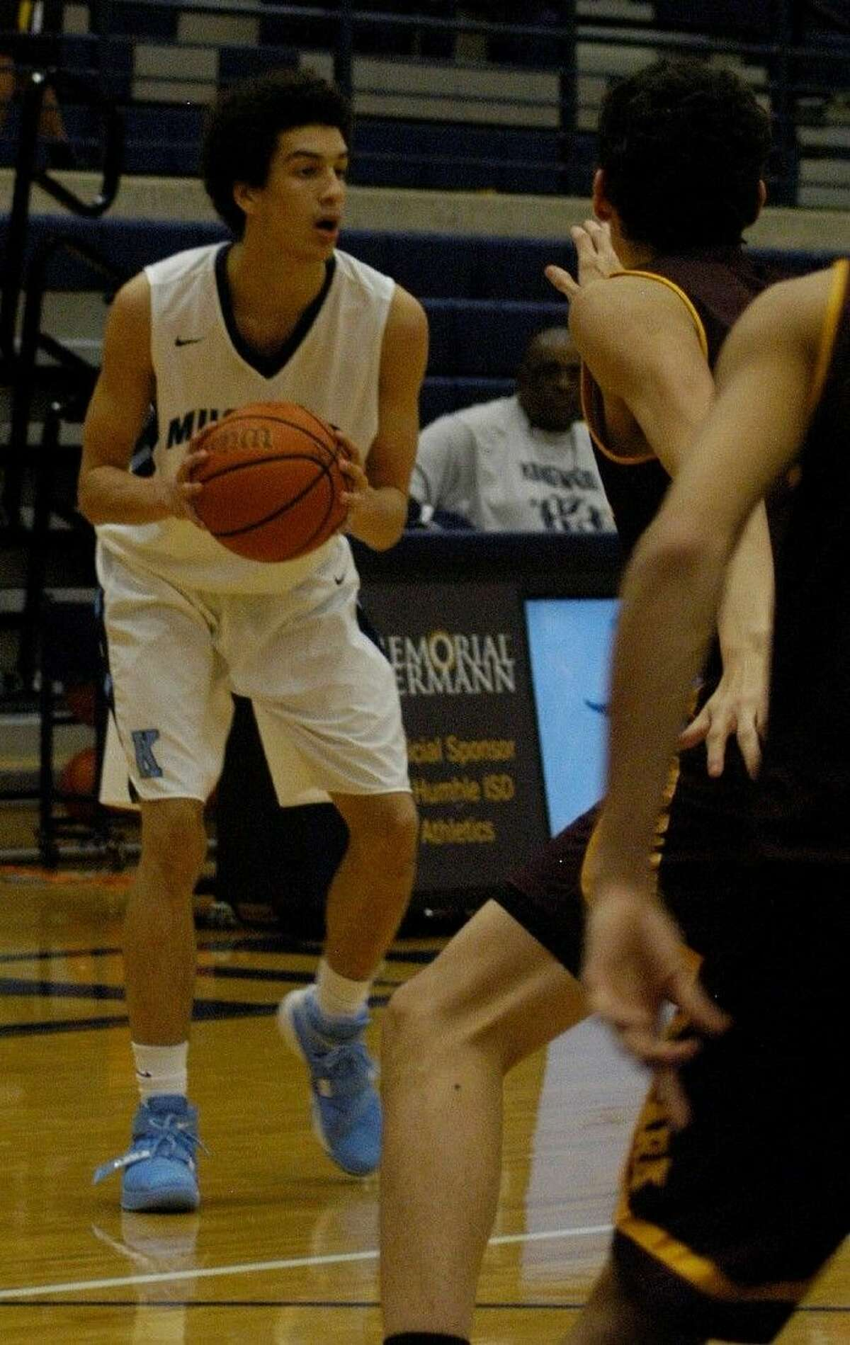 Kingwood's Deven Gould (35) prepares to drive the ball as Kingwood defeating Deer Park 55-40 on Tuesday, Dec. 8, 2015 at Kingwood High School.