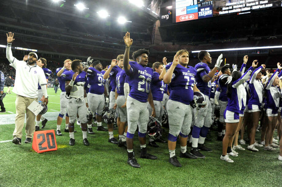 The Ridge Point football team celebrates a 35-27 against A&M Consolidated in the Class 5A Division II regional semifinals Nov. 28 at NRG Stadium in Houston. The Panthers finished the season 11-4 with their first state semifinal appearance. To view or purchase this photo and others like it, visit HCNpics.com. Photo: Craig Moseley