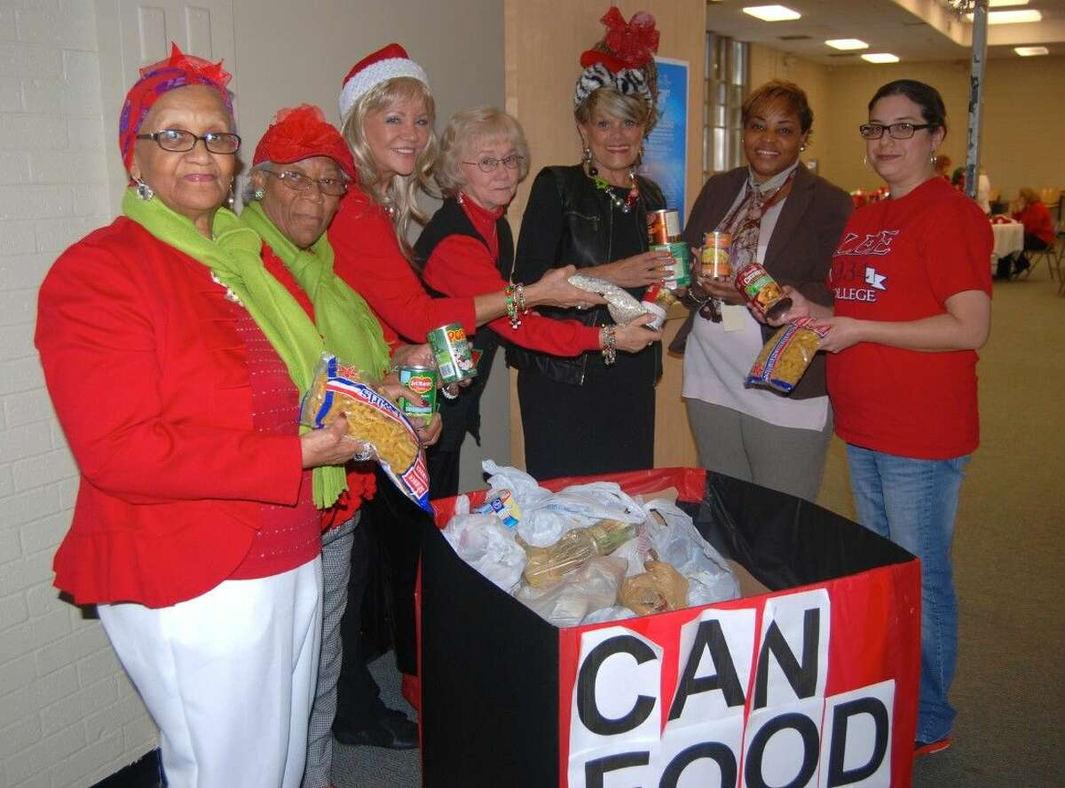 The Lee College chapter of the Red Hat Society donated more than 300 pounds of canned goods this week to help fill the pantry at Project Leeway.
