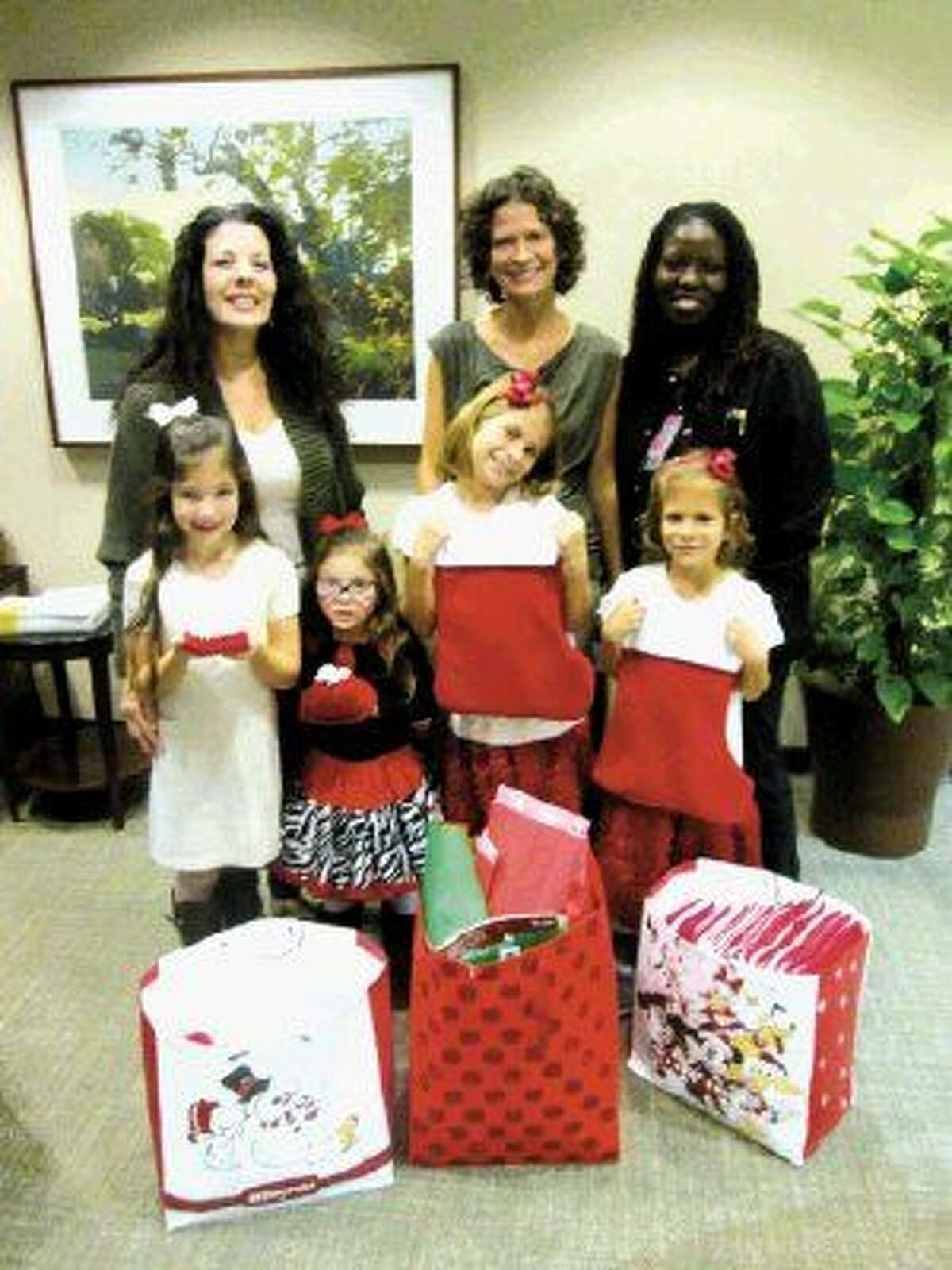 Pictured, from left in the front, are Isabella Simpson, Collins Simpson, Ryhlee Klen and Layla Klen. Behind the girls are their mothers, from left, Christina Simpson and Isabelle Klen and Kina Wright.